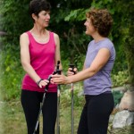 Margaret Martin Demonstrating Nordic Walking for Client