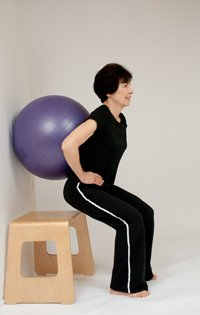 squats with ball against wall