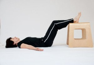 hip raise feet on chair; increase frequency of exercise routine