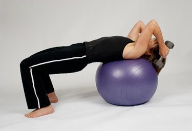 press with weight on stability ball