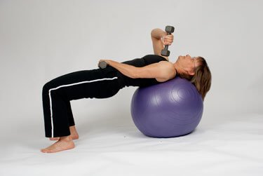 extension with weight on stability ball
